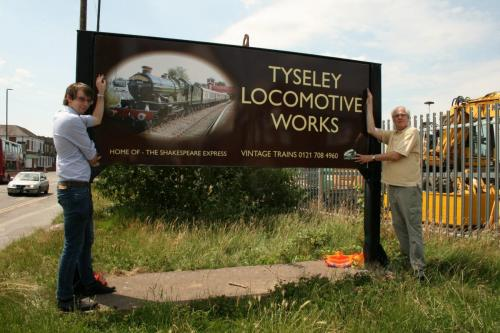 The new sign being handed over to Vintage Trains